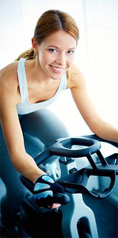 Fitnesscoach på cykel